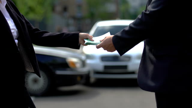 Woman giving bunch of euros to man, partners shaking hands, payment for service