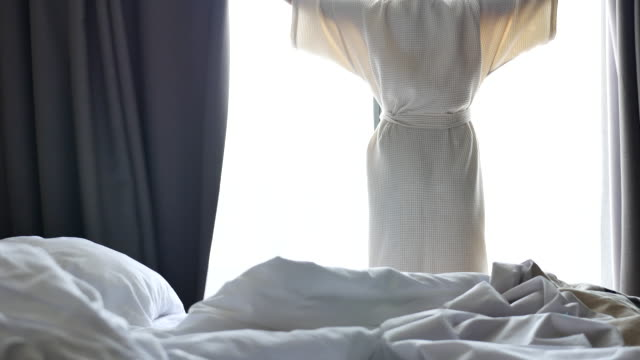 Woman Going opens the curtains in the morning video