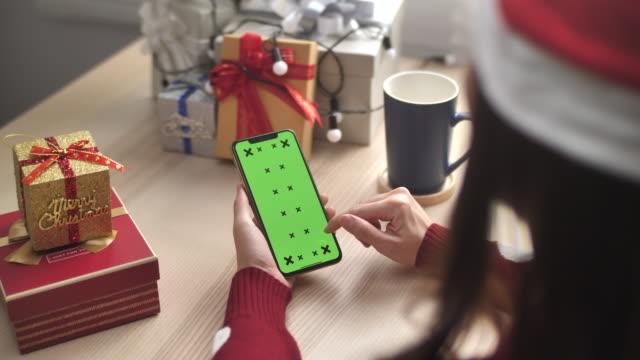 Woman Green screen Smart phone Online shopping for Christmas