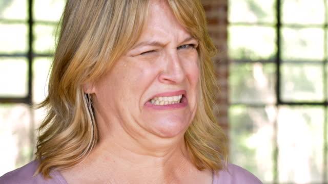 vídeos de stock e filmes b-roll de woman grossed out disgusted and expressing yuck face - cheiro desagradável