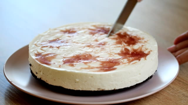 Woman hand cut Cheesecake. Breakfast time.Food background. video