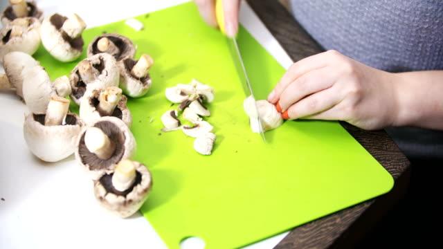 Woman Hand cutting mushrooms fungi video