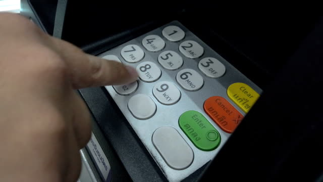 Woman hand entering PIN or pass code on ATM, bank machine keypad