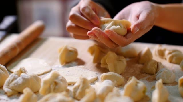 Woman hand holding Chinese Dumpling Jiaozi