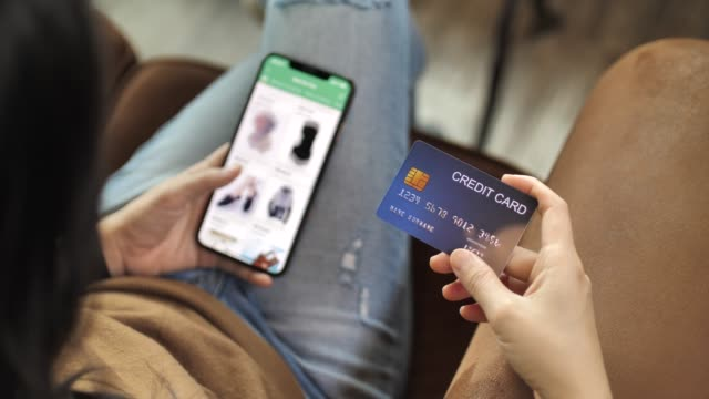 Woman Hand holding Credit card on her hand Online shopping on her Smart phone Woman Hand holding Credit card on her hand Online shopping on her Smart phone credit card purchase stock videos & royalty-free footage