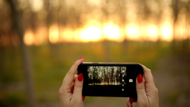 Woman hand holding smart phone shooting video video