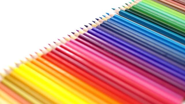 Woman hand pick up the color pencil arrange on desk video