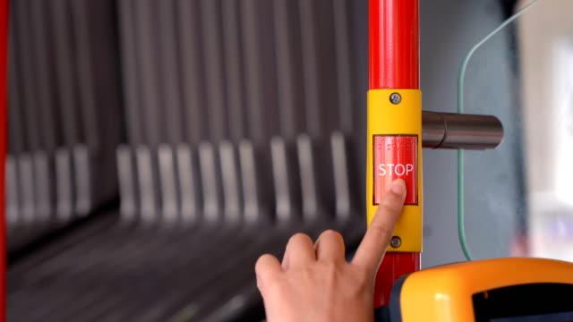 woman hand pressing bus stop button - клавишная панель стоковые видео и кадры b-roll