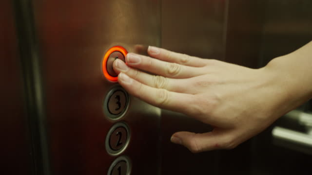 Woman hand pushing elevator button Pushing button in elevator push button stock videos & royalty-free footage
