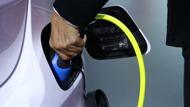 woman hand refueling alternative energy with car charger video