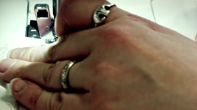 Woman hand sewing a white textile video