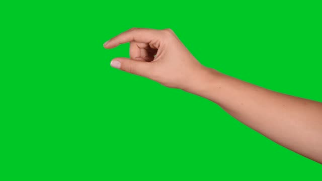 4K woman hand touchscreen gestures on green screen Hand carrying and putting something on chroma key. pinching stock videos & royalty-free footage