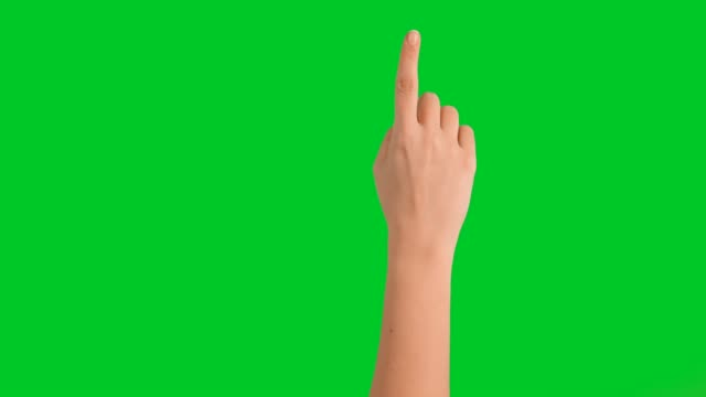 4k woman hand touchscreen gestures on green screen - scivolo video stock e b–roll