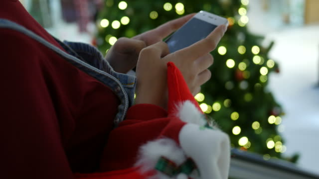 woman hand using phone on escalator in Christmas time video