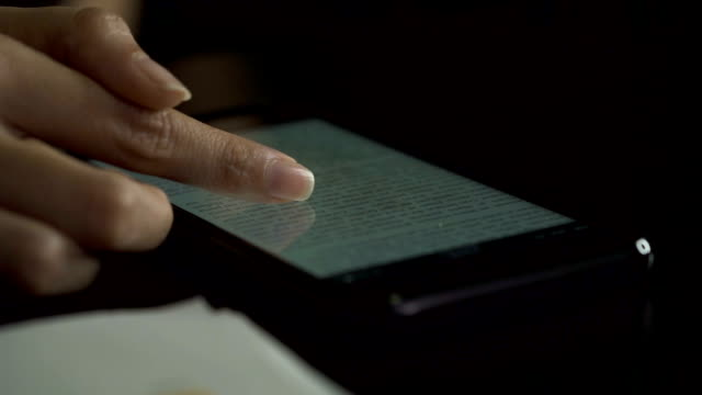 woman hand using smart phone to reading on ebook