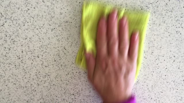 Woman hand wipes table top with rag Woman hand wipes table top with rag surface level stock videos & royalty-free footage
