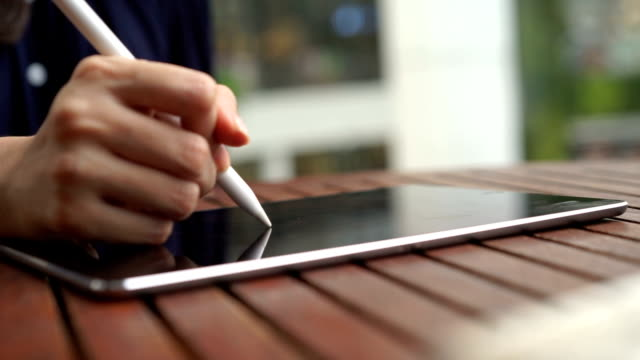 woman hand writing business plan on her tablet video