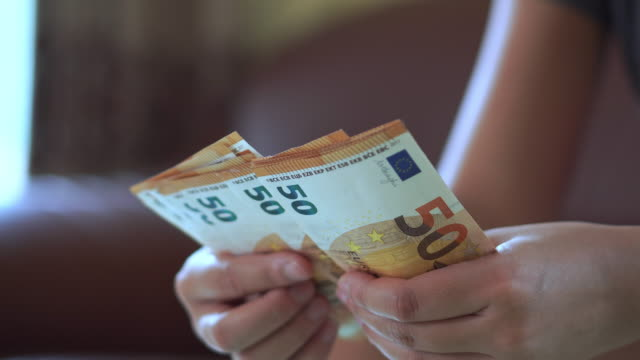 woman hands counting euro banknotes money and calculator cost. - valuta dell'unione europea video stock e b–roll