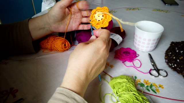 woman hands knitting colorful crochet - cucire video stock e b–roll