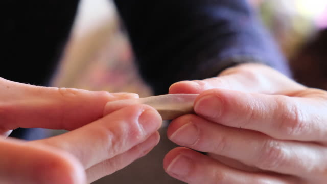 Woman hands making a joint Making a marijuana joint hashish stock videos & royalty-free footage