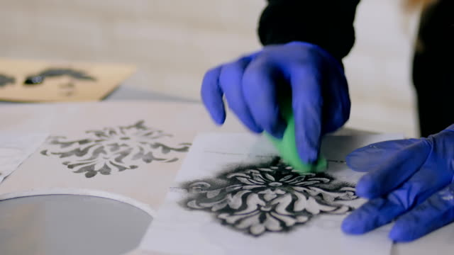 Woman hands painting wooden circle video