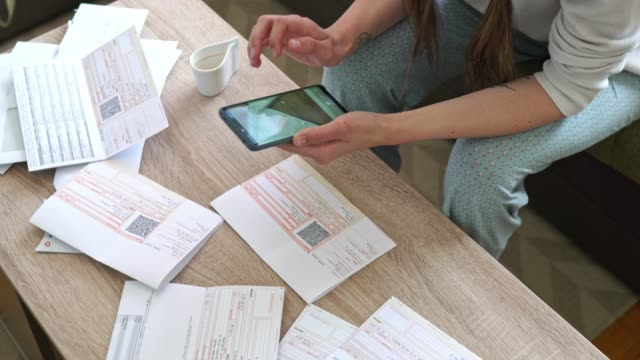 Woman hands scanning the QR code, paying bills with her phone video