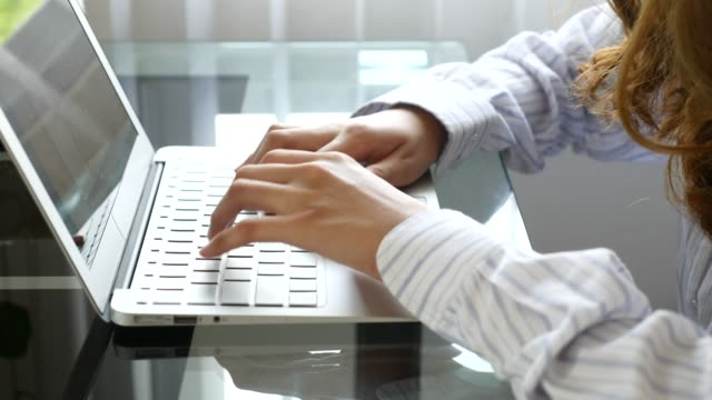 Woman hands using laptop computer, indoors