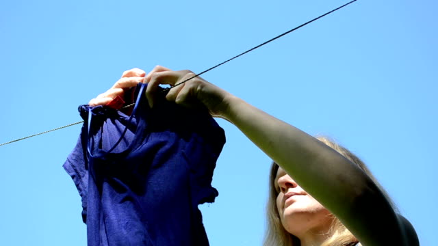woman hang laundry video