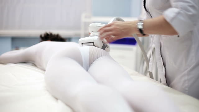 Woman have a massage with electronic massage system video