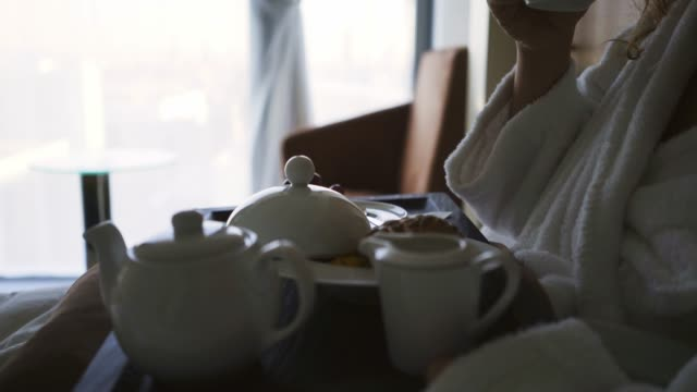Woman have breakfast in hotel apartment