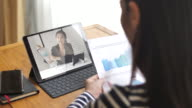 istock Woman have Video Conference with her Manager at home 1164969183