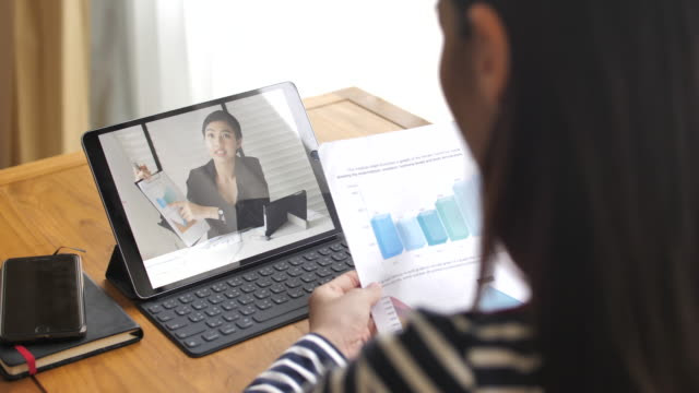 Woman have Video Conference with her Manager at home Woman have Video Conference with her Manager at home zoom call stock videos & royalty-free footage