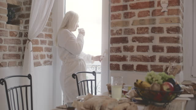 DS Woman having breakfast at home Dolly shot of a mid adult woman having breakfast on a sunny morning at home. Shoot in 8K resolution. mid adult women stock videos & royalty-free footage