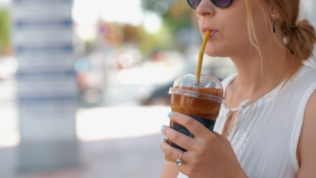 woman having chocolate drink in the street - paglia video stock e b–roll