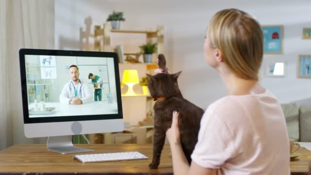 Woman Having Consultation with Online Vet