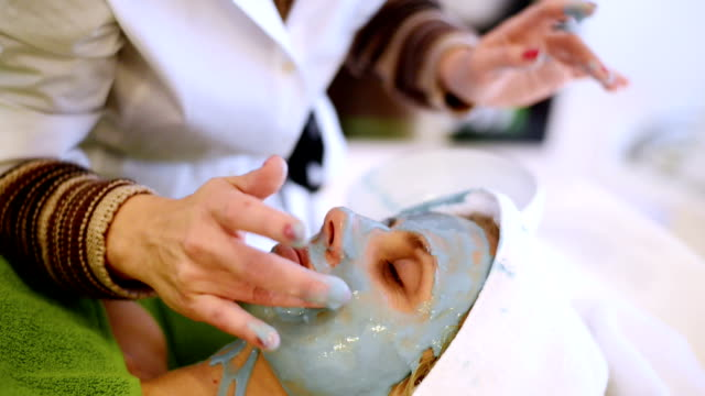 Woman having facial mask at beauty salon video