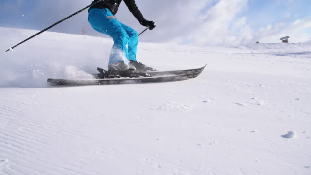 SLO MO Woman having fun carving down ski slope video