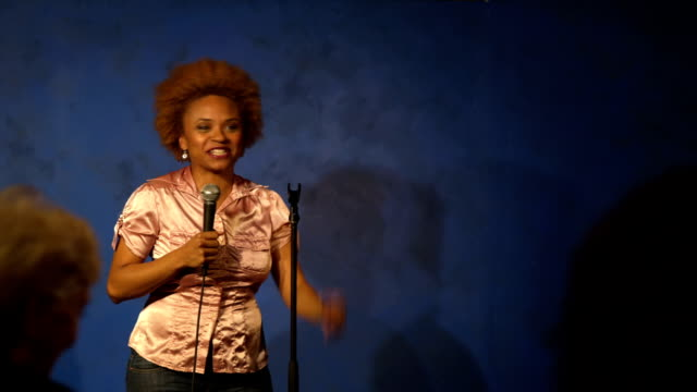 Woman having fun doing stand up video