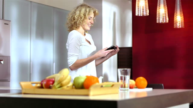 Woman Having Fun Using A Digital Tablet video