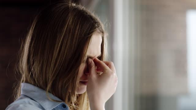 Woman having head pain at home