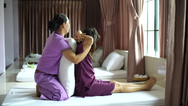 woman having relaxing with thai massage - cultura tailandese video stock e b–roll