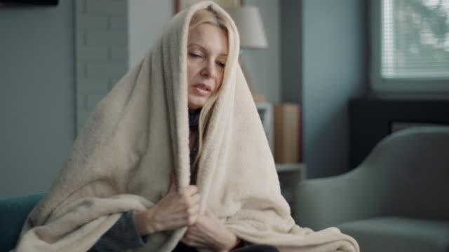 Woman having severe flu at home