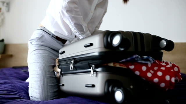 Woman having trouble packing video