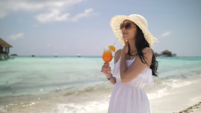 Woman Healthy drink on beach for Relaxing