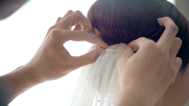 Woman Helping Bride Wearing a Wedding Veil video