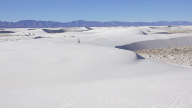 Woman hiker explores White Sands National Monument New Mexico mountains video