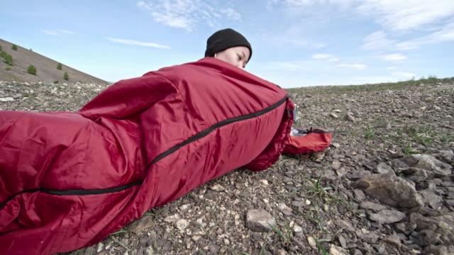 Woman Hiker Resting in Sleeping Bag