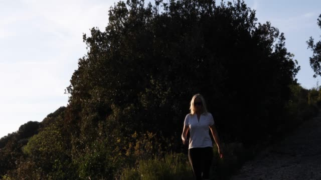 Woman hikes above valley and mountains At sunrise, she looks off to distant scene, Liguria pedal pushers stock videos & royalty-free footage