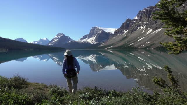 Woman hikes Bow Lake Banff National Park Alberta Canada glacier video