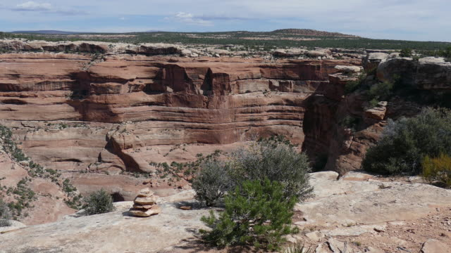 Woman hikes Cedar Mesa Trail of the Ancients ruin Utah video